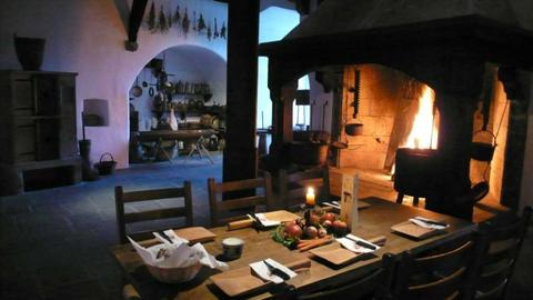 The medieval kitchen with the table set for dinner